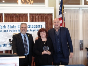 In the photo above from left to right, Chief Robert Pavone, New York State Crime Stoppers Chairman presents Colonel Patricia Groeber with an award as actor Vincent D'Onofrio stands by